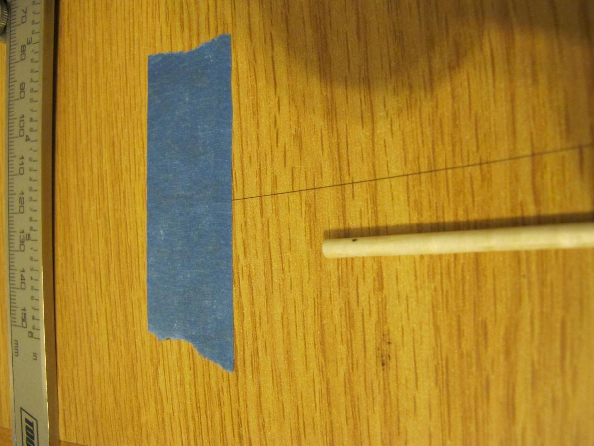 Attaching one end of boron with blue tape